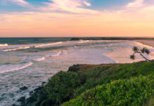 The beach view with pinky sunset in summer time on the beach in Ballina, Byron bay, Australia photo via Depositphotos
