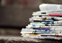 stack of newspapers - image by congerdesign from Pixabay