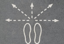footprints and directional arrows - photo by imelenchon via Morguefile
